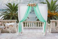 Wedding arch for the ceremony of flowers Stock Photos