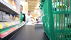 Customer at Cash-desk with Cashier in Supermarket Stock Footage