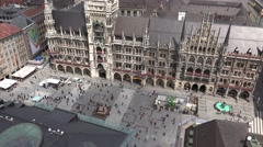 4K Famous aerial view New Town Hall Clock Tower Munich Marys Square Rathaus day  Stock Footage