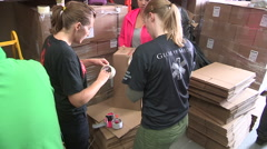 Workers packaging aid supplies for refugees from war in Syria and middle east Stock Footage
