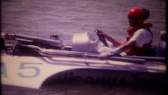 2574 - hydro boat racing action at local lake - vintage film home movie Stock Footage