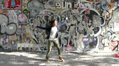 Happy girl dancing jumping and falling on the ground slow motion 120fps Stock Footage
