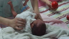 One day old newborn baby making exercise by the nurse after taking a bath Stock Footage