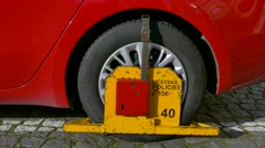 Wheel clamp from Police on car, Budweis, Czech Republic Stock Footage