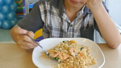 Little boy eating fried rice . - stock footage