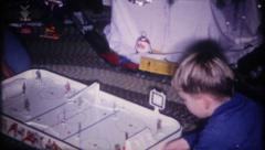 2580 - Christmas morning, brothers play with hockey game-vintage film home movie - stock footage