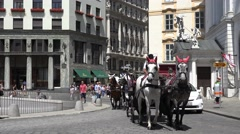4K Traffic horse-drawn Vienna downtown tourism attraction passenger enjoy town  Stock Footage