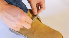 Man tying shoelaces on shoes yellow Stock Footage