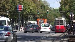 4K Heavy traffic street Vienna large avenue old tram pass car pedestrian people  Stock Footage