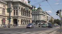 4K State Opera building traffic street old tramway pass car wait Vienna downtown Stock Footage
