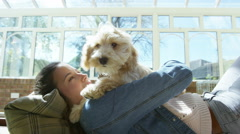 4K Woman relaxing at home with cute young puppy - stock footage