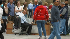 People watching two men playing chess in a square in Stuttgart Stock Footage