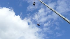 4k Couple jumping bungee jump form huge crane in Berlin - stock footage