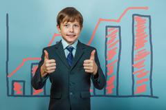 A boy of twelve European appearance in a suit holding a blank sh Stock Photos