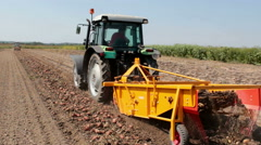 Potato digger in operation in the field Stock Footage