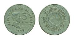 Philippine five peso coins isolated on white - stock photo