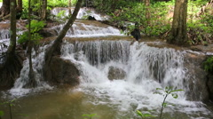 Waterfall in tropical forest in Kanchanaburi, Thailand with audio - stock footage