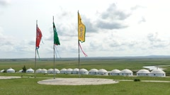 Hulunbuir endless Grassland with white yurts Stock Footage