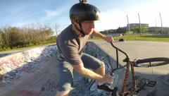 Bmx slow motion head mount tailwhip jump Stock Footage