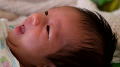 Baby begins to stir and wake up, then looks confused Stock Footage