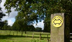 Public footpath sign points left and right Stock Photos