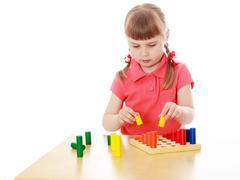 Girl in a Montessori environment - stock photo