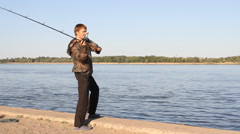 Man fishing on a river Stock Footage