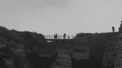 People crossing the small bridge in the mountain Stock Footage
