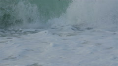 Splashing of big waves in Etretat beach Stock Footage