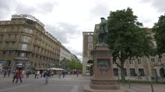 Tourists walking in front of Christoph Herzog von Wuerttemberg Statue, Stuttgart Stock Footage