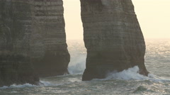 Big waves splashing on the rocks of the cliff Stock Footage