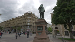 People taking pictures of Christoph Herzog von Wuerttemberg Statue, Stuttgart Stock Footage