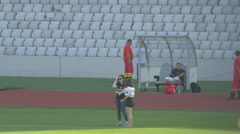 WStaff members and paramedics standing on the Cluj Arena field in Cluj-Napoca - stock footage