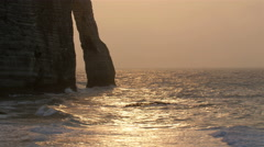 Late afternoon view of the beach and cliff in Etretat Stock Footage