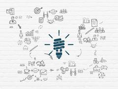 Finance concept: Energy Saving Lamp on wall background Stock Illustration