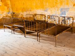 Old rusty beds in abandoned room Stock Photos
