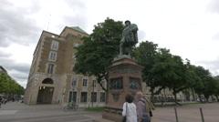 Walking in front of Christoph Herzog von Wuerttemberg Statue, Stuttgart Stock Footage