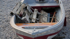 Closer look of the boat on the shore of Etretat beach Stock Footage