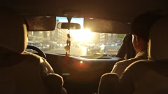 Riding in a car in the city. Sunset time. atmosphere of the city Stock Footage