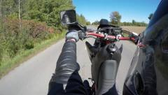 Stock Video Footage of 4k motorcycle wheelie helmet - side mount view