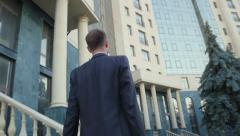 Young, personable businessman sent to the office building Stock Footage