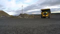 Big downloaded juggernaut with headlights leaves the quarry. - stock footage