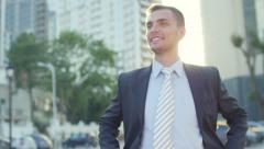 Portrait of the attractive confident businessman standing before office building Stock Footage