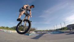 Bmx footjam tailwhip over camera neat angle Stock Footage