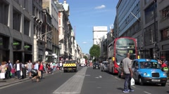 4K Busy street downtown London British capital car pass pedestrian people walk  Stock Footage