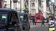 4K Crowded London metropolis traffic red bus double decker pedestrian people day Stock Footage