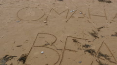 Stock Video Footage of Writing on the sand on Omaha Beach