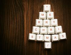 Stock Photo of Christmas tree made of computer keys,tree background with vignette