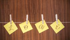 Post-it notes with the text love - stock photo