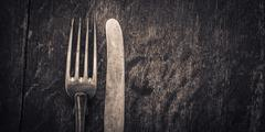 Vintage silverware on rustic wooden background Stock Photos